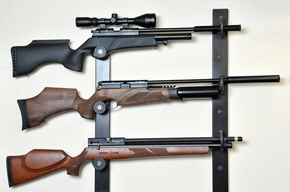 Guns on display in a wall-mounted rack