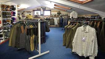Interior of the Trulock and Harris shop showing the clothing area